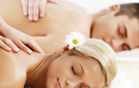 man and woman enjoying couple's massage