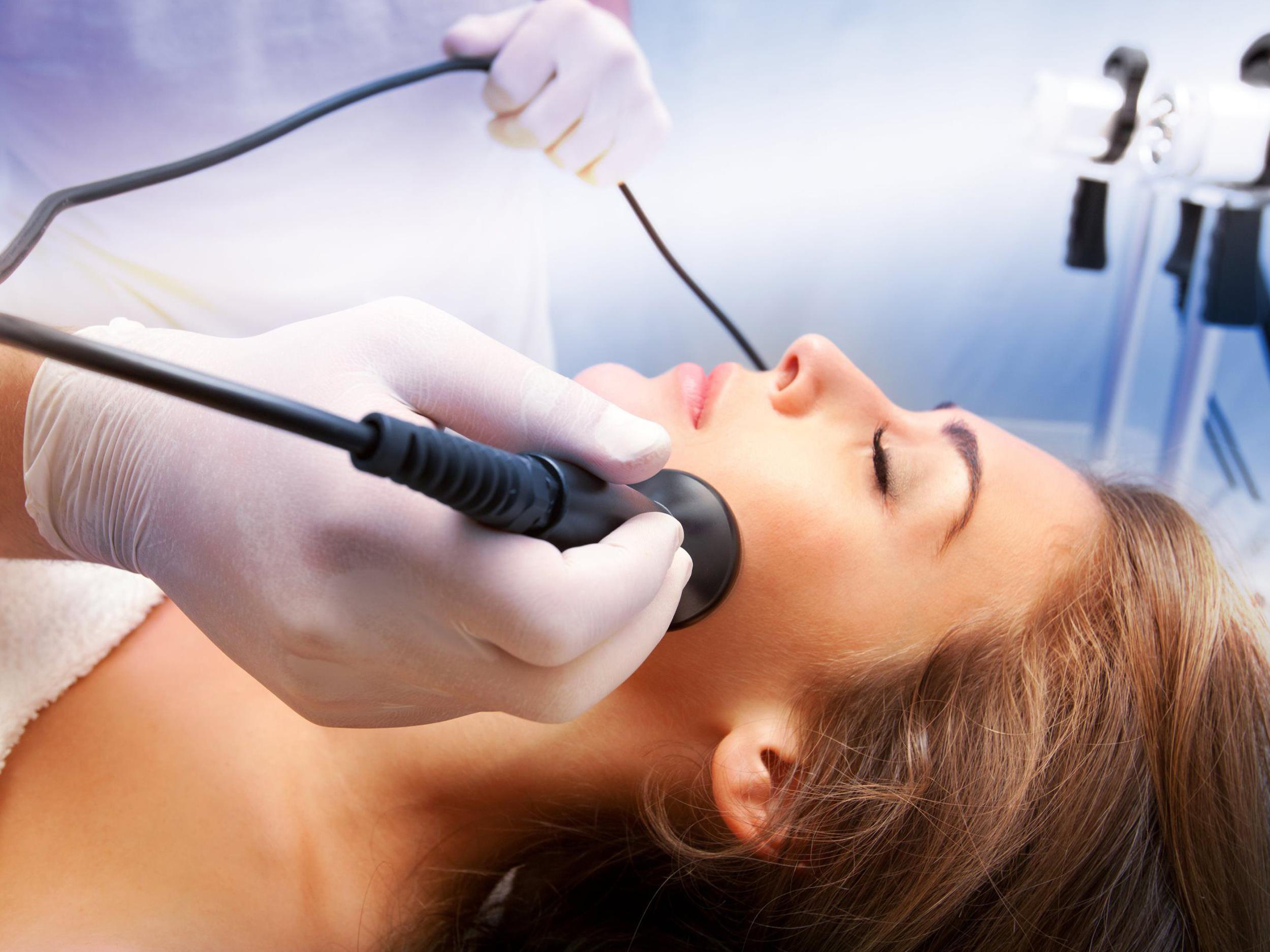 woman enjoying microdermabrasion